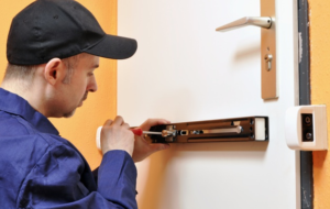 a-locksmith-contractor-working-on-a-door